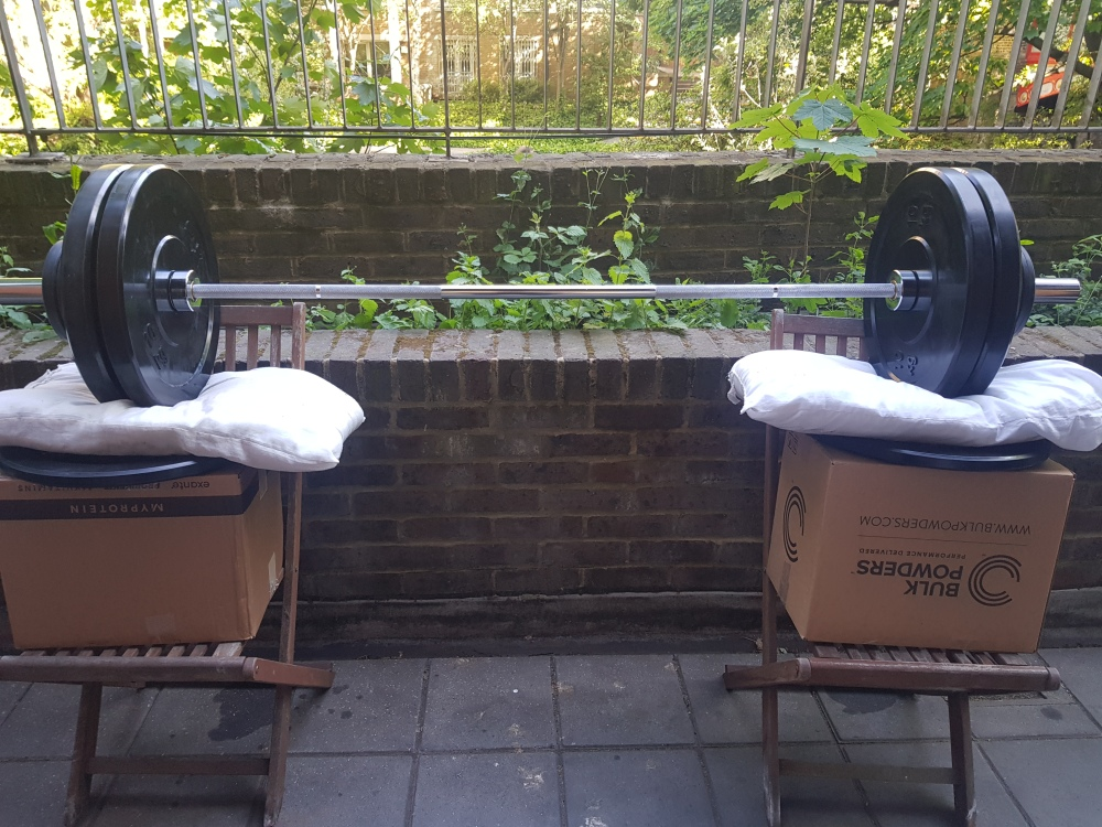 Homemade squat rack. Not the strongest but it does the job.
